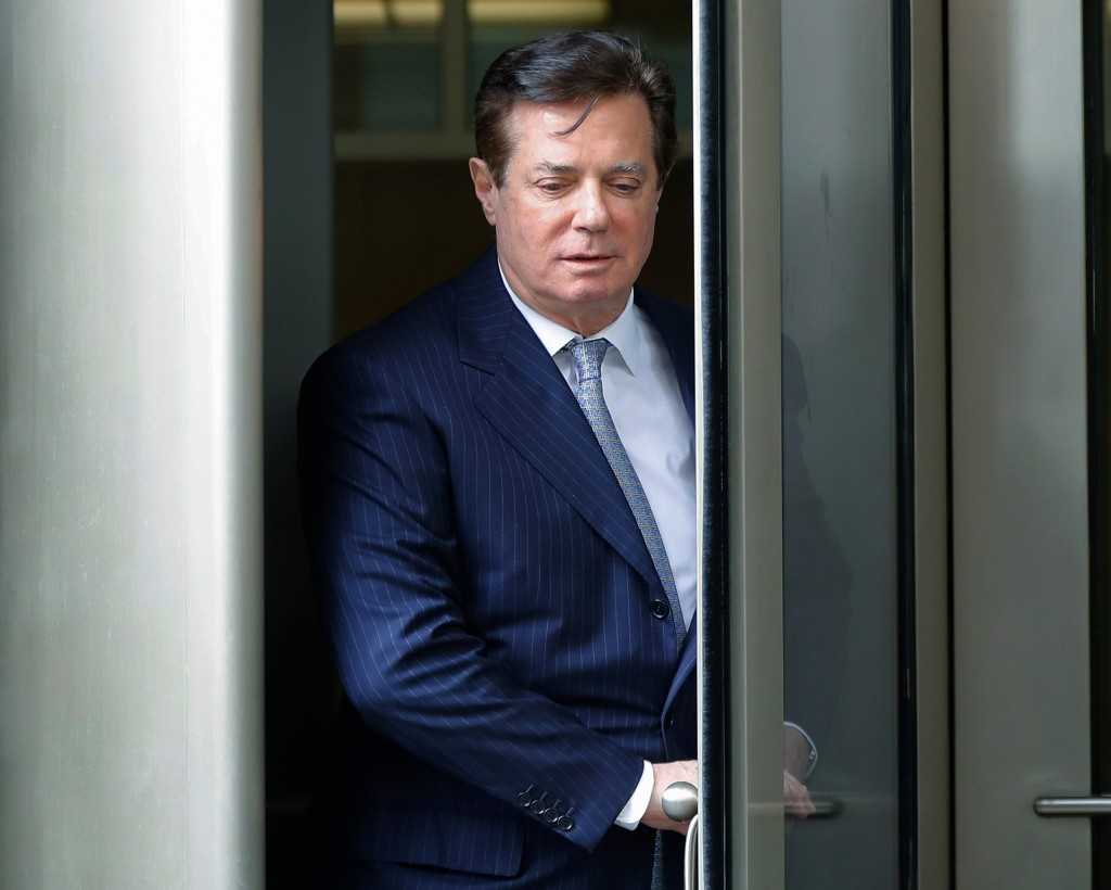 FILE - In this Feb. 14, 2018, file photo, Paul Manafort leaves the federal courthouse in Washington. Manafort, President Donald Trump's imprisoned for...