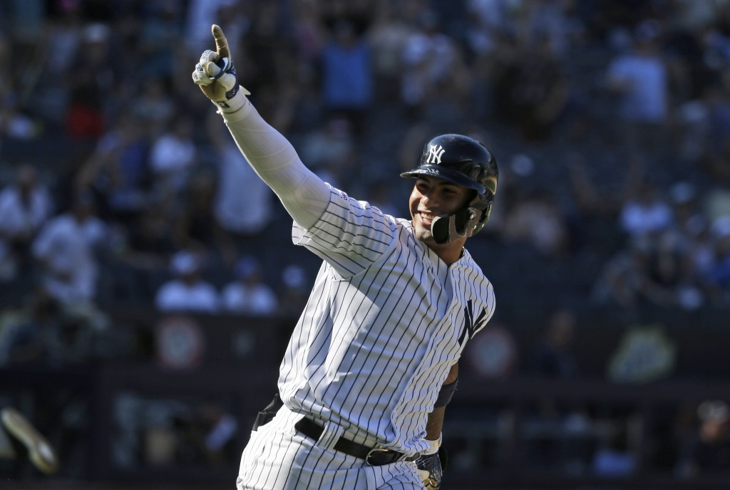 New York Yankees' Gleyber Torres reacts after hitting a walk-off RBI single during the ninth inning of a baseball game at Yankee Stadium, Wednesday, J...
