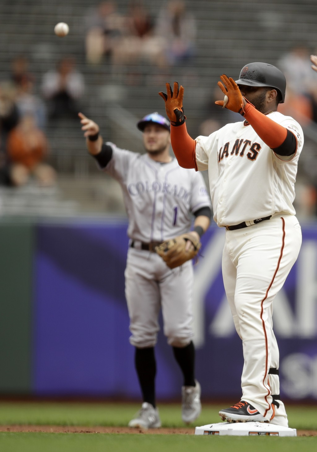 San Francisco Giants' Pablo Sandoval, right, celebrates after hitting an RBI double against the Colorado Rockies in the first inning of a baseball gam...