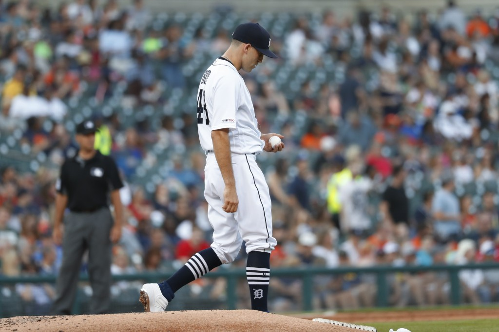 Detroit Tigers pitcher Matthew Boyd walks to the mound after allowing a Texas Rangers' Danny Santana solo home run in the fifth inning of a baseball g...