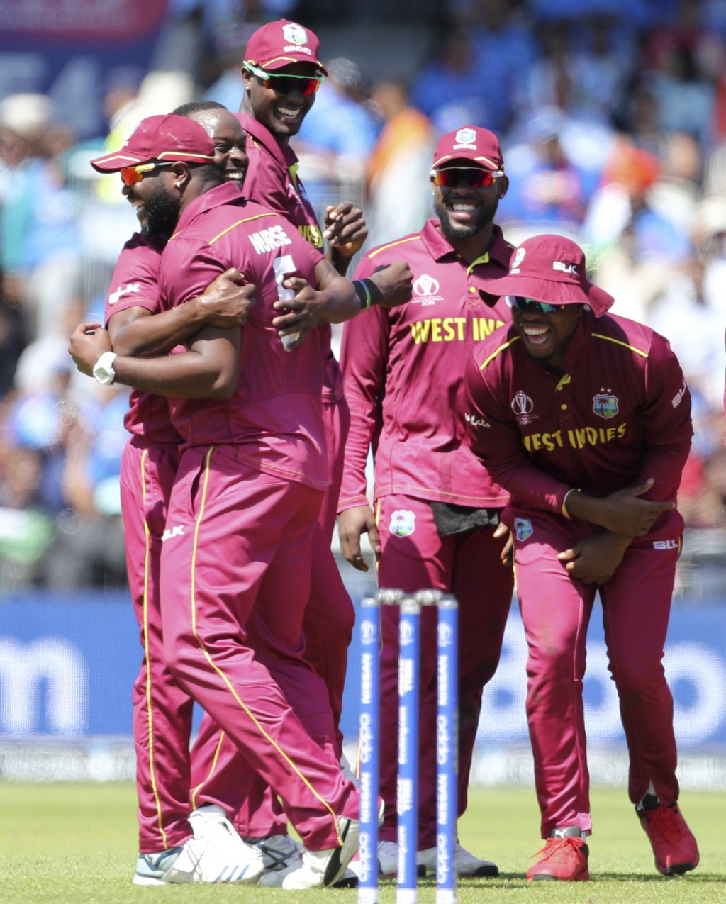 West Indies' Kemar Roach, left, and teammates celebrate the dismissal of India's Kedar Jadhav during the Cricket World Cup match between India and Wes...