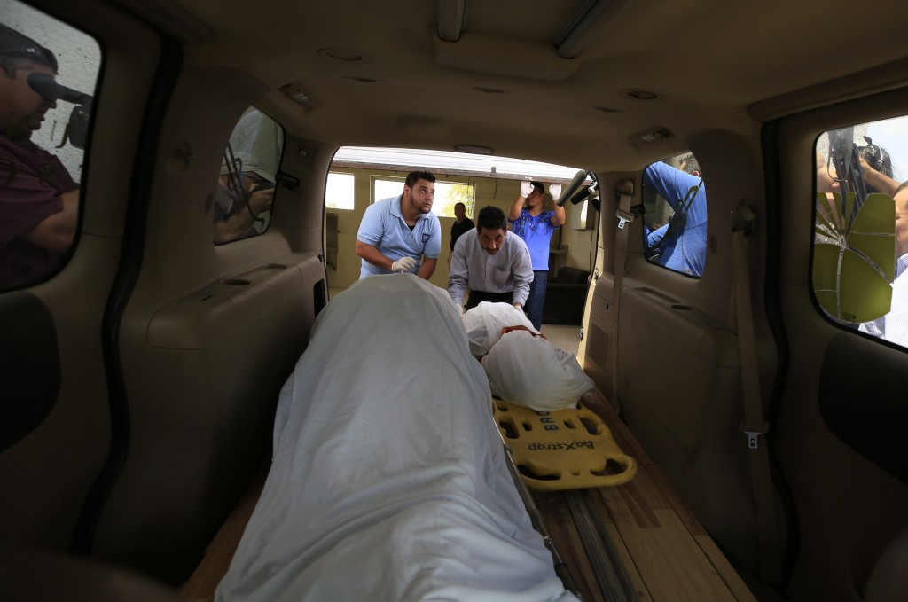 The bodies of El Salvadoran migrant Oscar Alberto Martinez Ramírez, 25, and his nearly two-year-old daughter Valeria, are placed into a funeral home v...