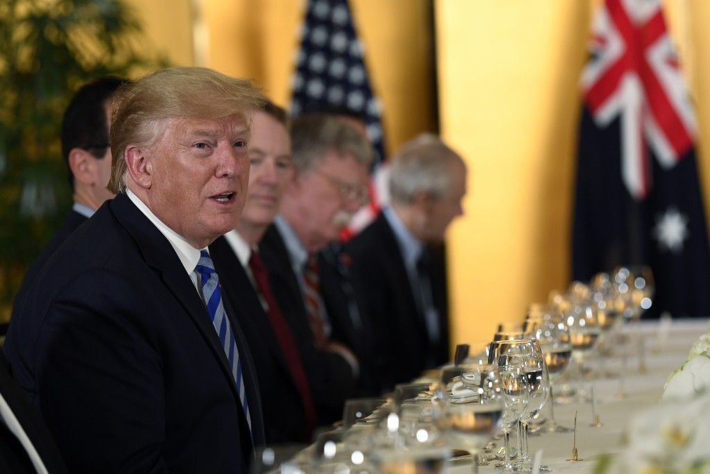 President Donald Trump, left, speaks as he attends a dinner with Australian Prime Minister Scott Morrison in Osaka, Japan, Thursday, June 27, 2019. Tr...