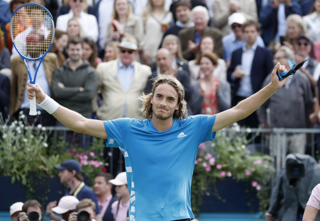 FILE - In this June 20, 2019, file photo, Stefanos Tsitsipas, of Greece, celebrates after winning a singles match against Jeremy Chardy, of France, at...