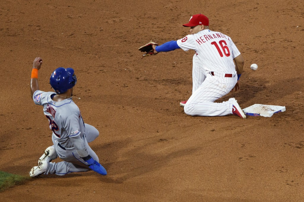 New York Mets' Dominic Smith, left, steals second base as Philadelphia Phillies second baseman Cesar Hernandez reaches for the throw during the sixth ...