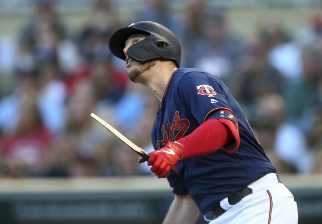 Minnesota Twins' C.J. Cron watches his broken-bat RBI single off Tampa Bay Rays pitcher Charlie Morton during the first inning of a baseball game Wedn...