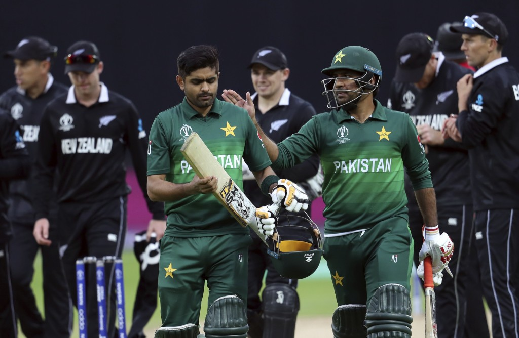 Pakistan's captain Sarfaraz Ahmed, right, pat on the shoulder teammate Babar Azam for scoring a century at the end of the Cricket World Cup match betw...