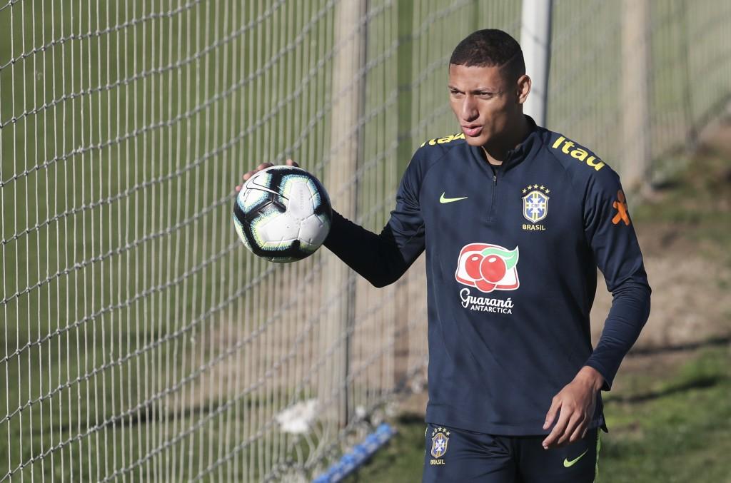 Richarlison holds a ball during a training session of Brazil national soccer team in Porto Alegre, Brazil, Wednesday, June 26, 2019. Brazil will play ...