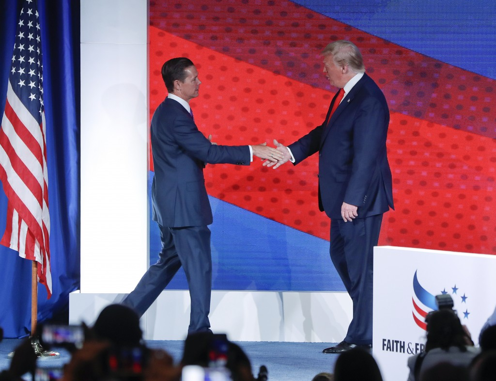 President Donald Trump, right, greets Ralph Reed, left, founder and chairman of the Faith & Freedom Coalition, before speaking at the Faith & Freedom ...