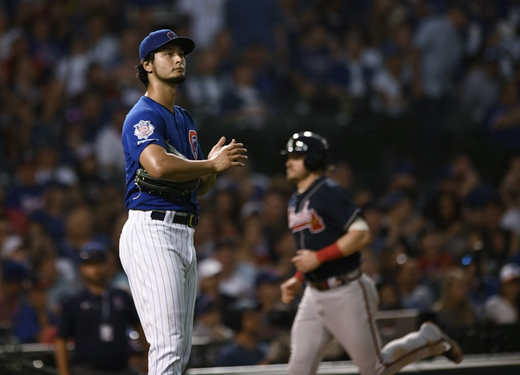 Chicago Cubs starting pitcher Yu Darvish reacts after giving up a three-run home run to Atlanta Braves' Nick Markakis during the third inning of a bas...