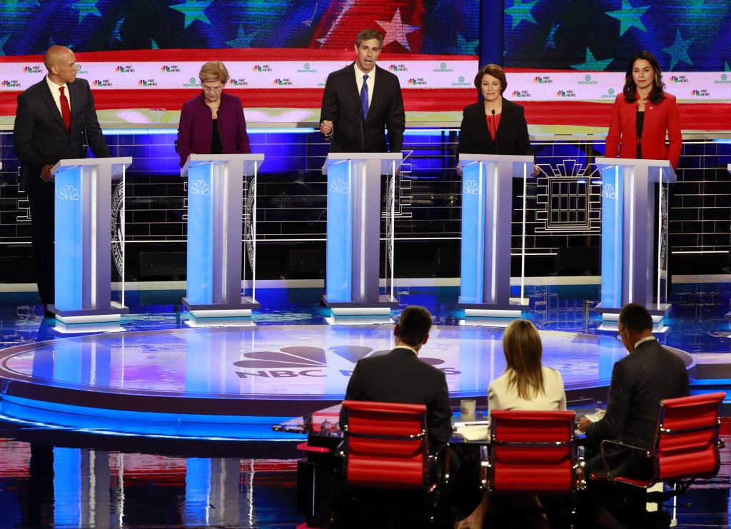 Democratic presidential candidate former Texas Rep. Beto O'Rourke, center, answers a question, during a Democratic primary debate hosted by NBC News a...