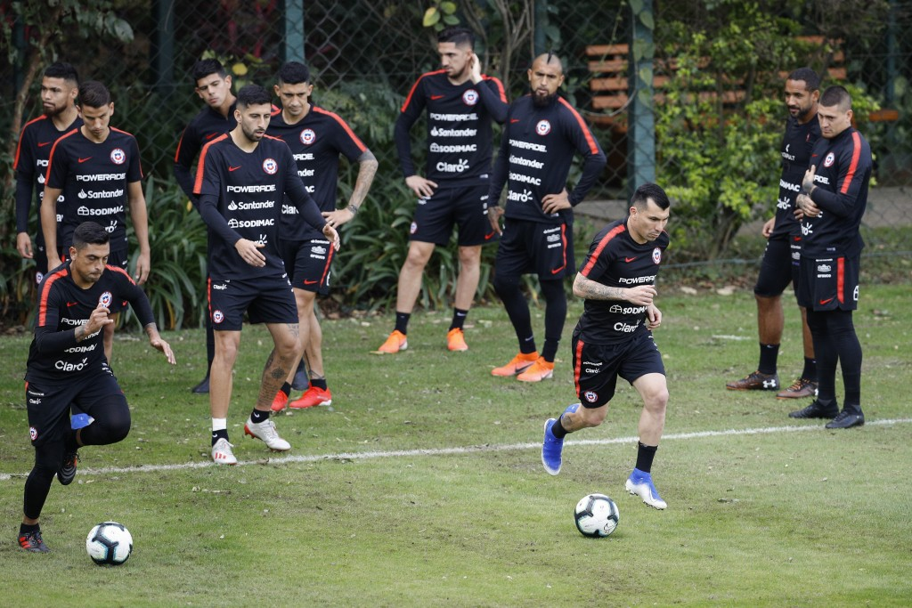 Chile's Gary Medel, third right, runs with the ball during a training session in Sao Paulo, Brazil, Wednesday, June 26, 2019. Chile will face Colombia...