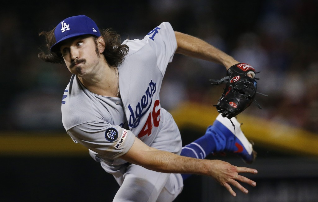 Los Angeles Dodgers starting pitcher Tony Gonsolin delivers against the Arizona Diamondbacks during the first inning of a baseball game Wednesday, Jun...