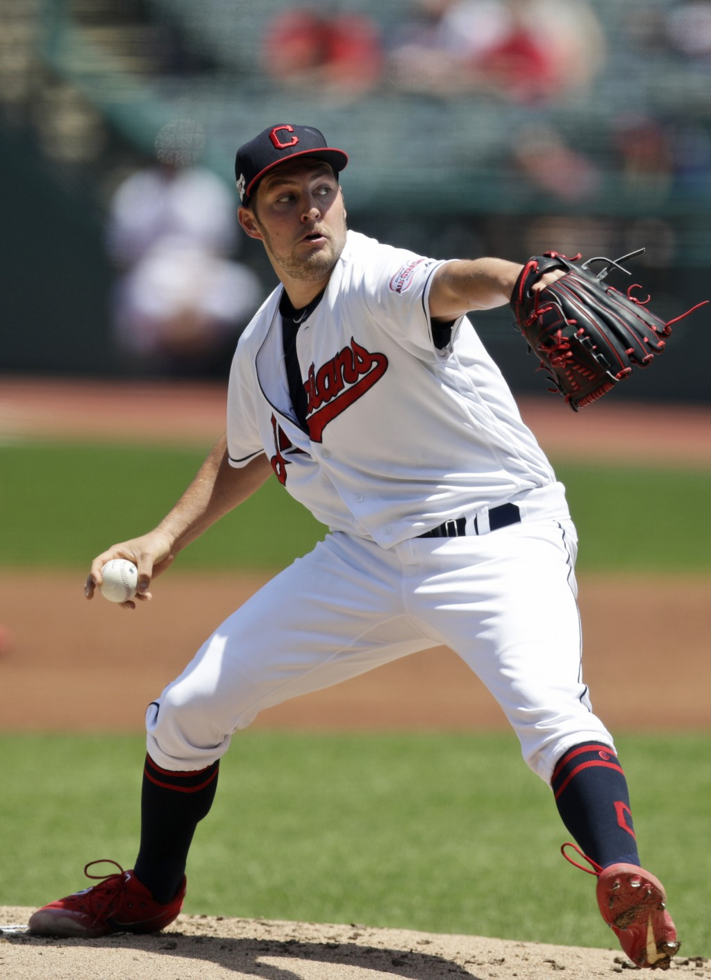 Cleveland Indians starting pitcher Trevor Bauer delivers in the first inning in a baseball game against the Kansas City Royals, Wednesday, June 26, 20...