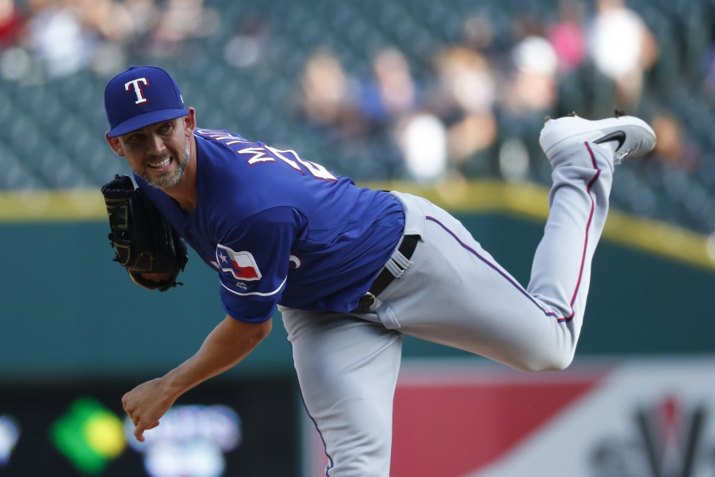 Texas Rangers pitcher Mike Minor throws against the Detroit Tigers in the first inning of a baseball game in Detroit, Wednesday, June 26, 2019. (AP Ph...