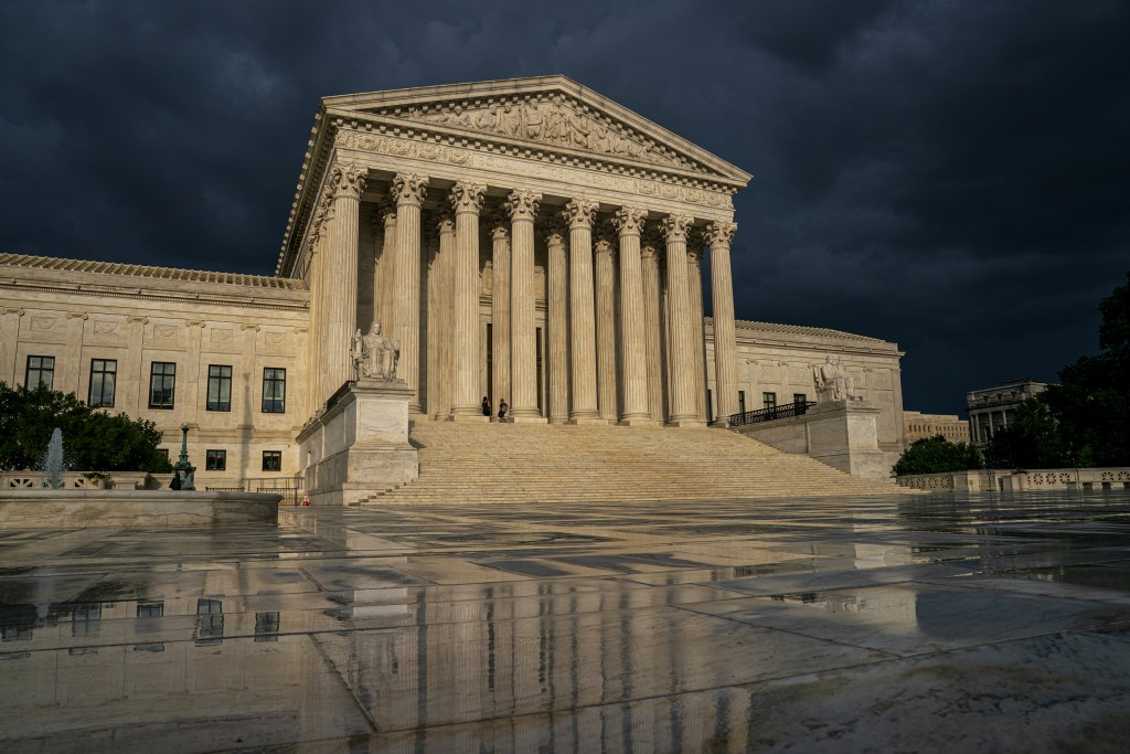 FILE - In this June 20, 2019 file photo, the Supreme Court is seen under stormy skies in Washington. Two issues that could determine the distribution ...