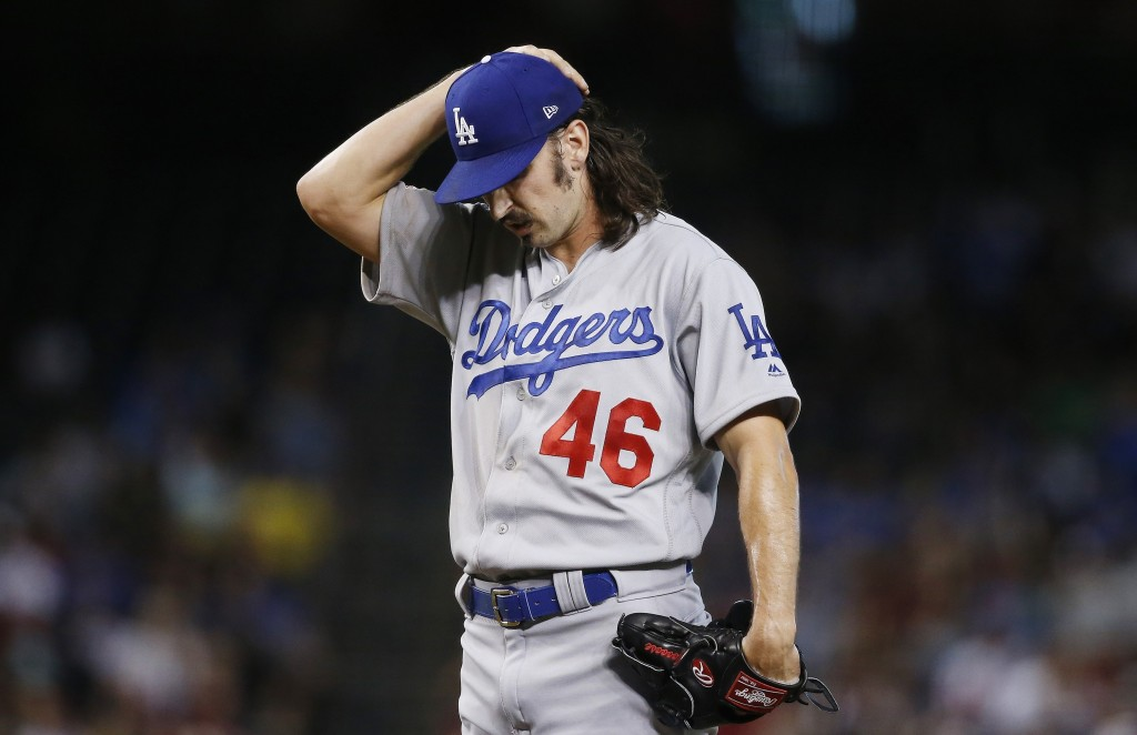 Los Angeles Dodgers starting pitcher Tony Gonsolin pauses on the mound during the first inning of a baseball game against the Arizona Diamondbacks Wed...