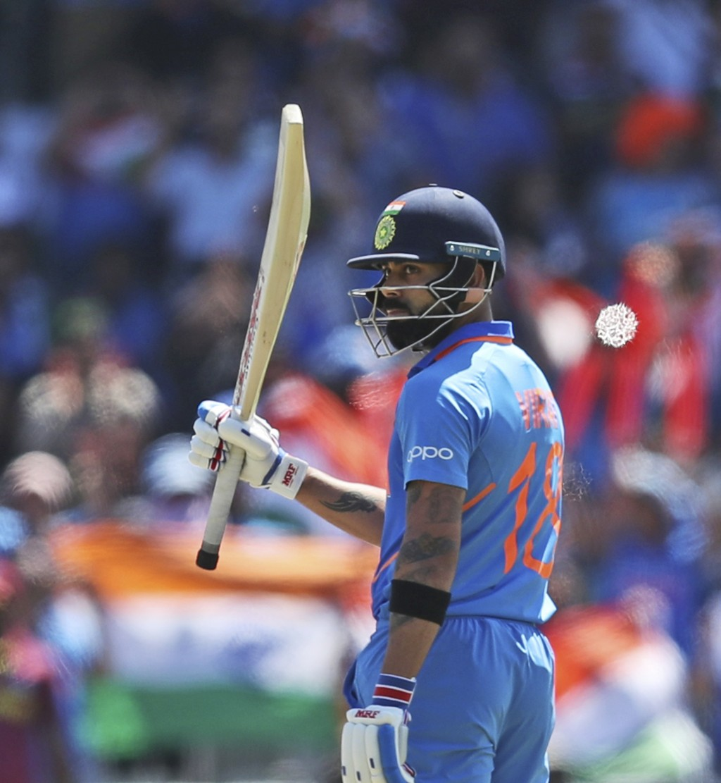 India's captain Virat Kohli celebrates after scoring fifty runs during the Cricket World Cup match between India and West Indies at Old Trafford in Ma...