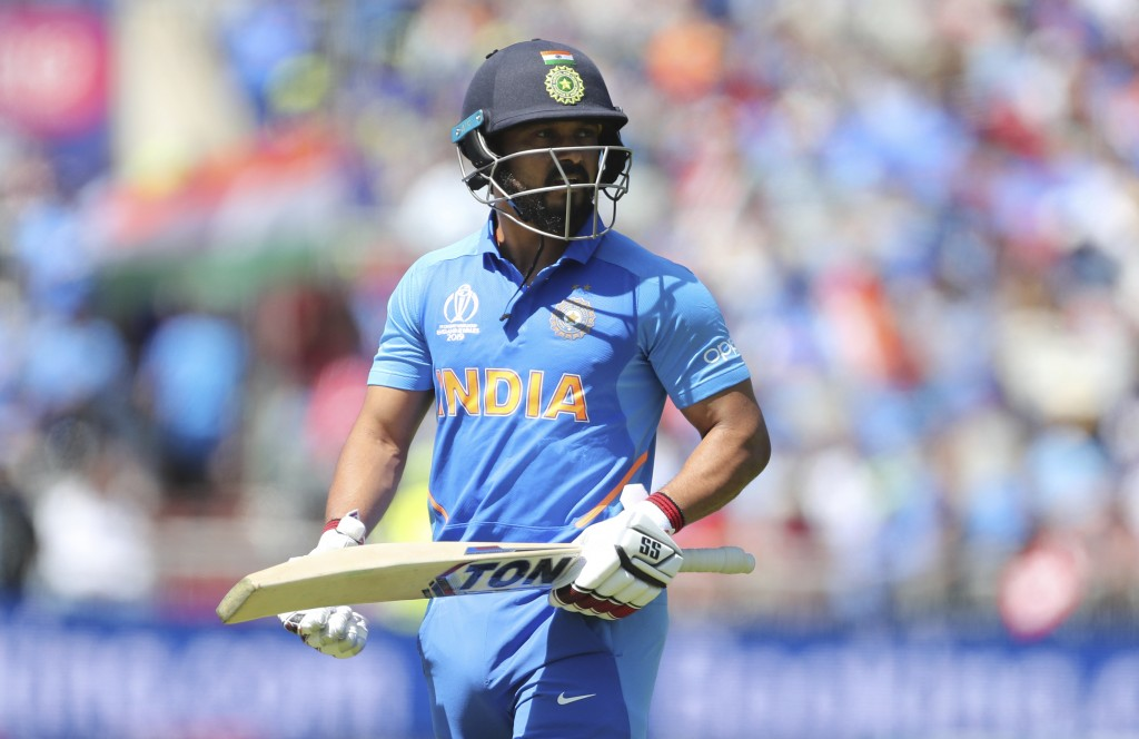 India's Kedar Jadhav leaves the field after being dismissed by West Indies' Kemar Roach during the Cricket World Cup match between India and West Indi...