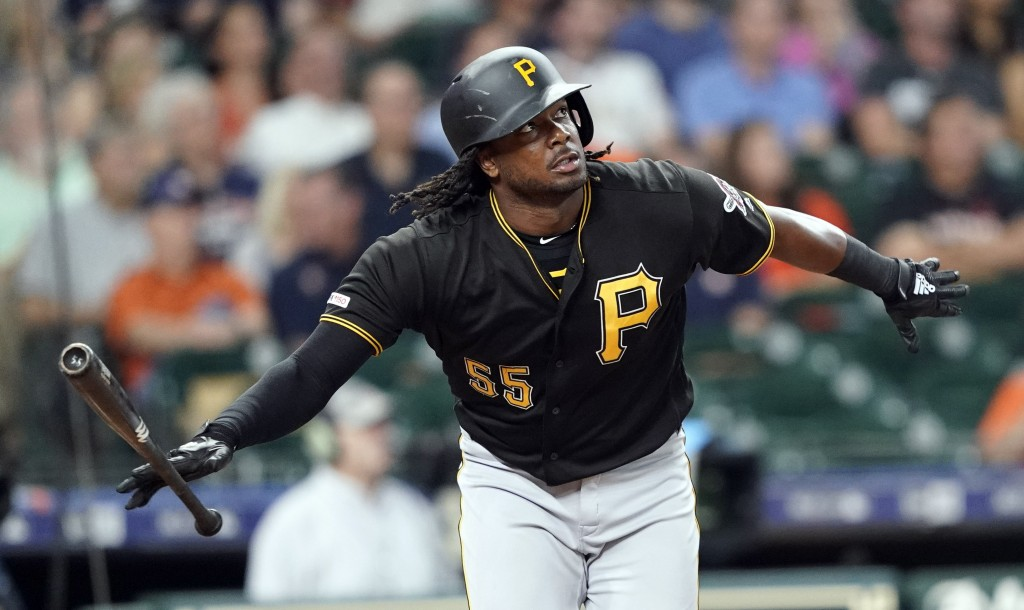 Pittsburgh Pirates' Josh Bell drops his bat after hitting a two-run home run against the Houston Astros during the first inning of a baseball game Wed...