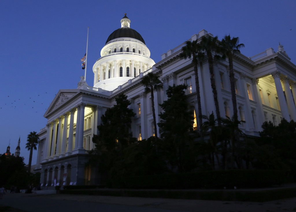 FILE - In this Aug. 31, 2018, photo the lights of the Capitol dome shine as lawmakers work into the night in Sacramento, Calif. California picked up a...