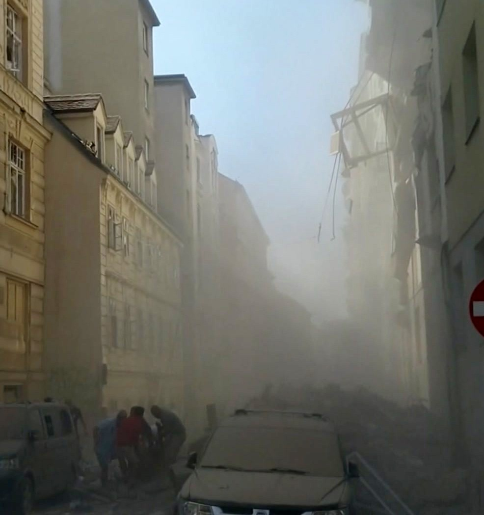 In this image made from video provided by W. Ressl, people survey the damage after an explosion at a building in Vienna, Austria, Wednesday, June 26, ...
