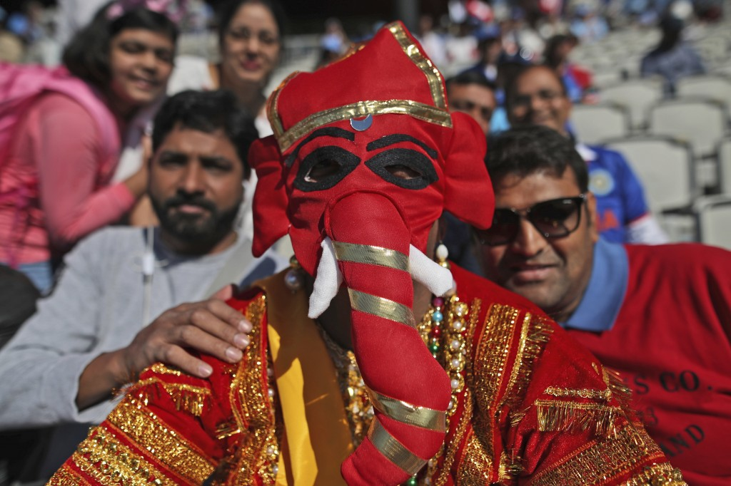An Indian fan dressed as Hindu elephant-headed God Ganesha watches the Cricket World Cup match between India and West Indies at Old Trafford in Manche...