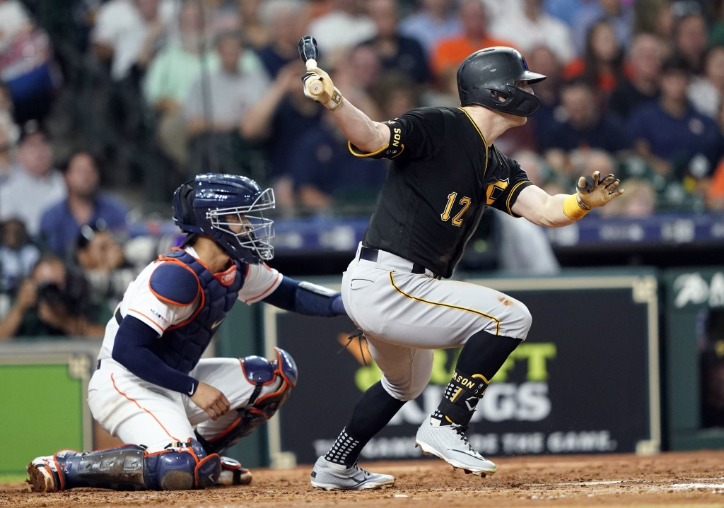 Pittsburgh Pirates' Corey Dickerson (12) hits a two-run single as Houston Astros catcher Robinson Chirinos watches during the third inning of a baseba...