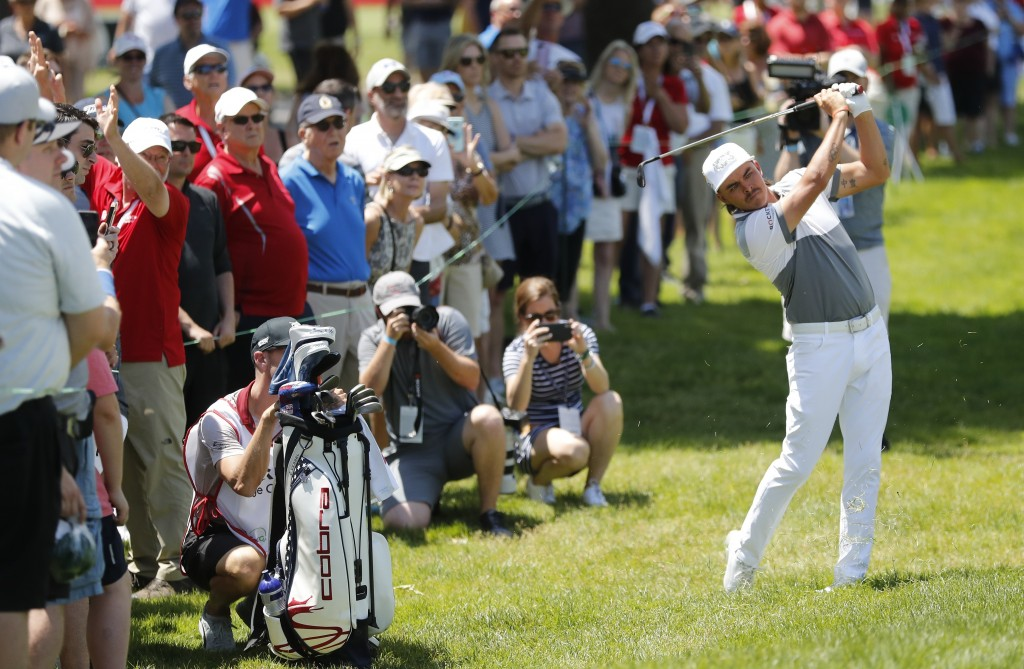 Rickie Fowler hits his second shot on the 18th hole during Pro-Am at the Rocket Mortgage Classic golf tournament, Wednesday, June 26, 2019, in Detroit...