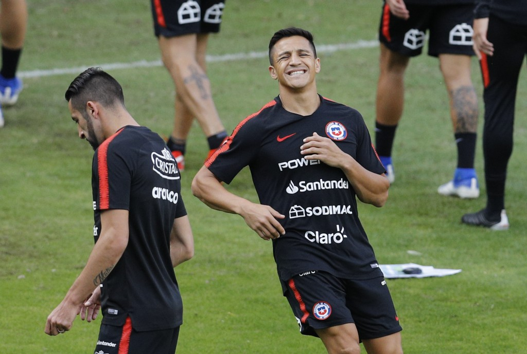 Chile's Alexis Sanchez grimaces during a training session in Sao Paulo, Brazil, Wednesday, June 26, 2019. Chile will face Colombia on June 28 for the ...