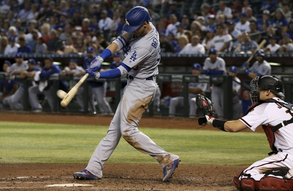 Los Angeles Dodgers' Cody Bellinger (35) connects for a home run as Arizona Diamondbacks catcher Caleb Joseph, right, reaches out for the baseball dur