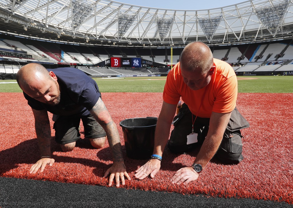 Workers prepare the pitch during an unveiling of the London Stadium in London, Thursday, June 27, 2019. Major League Baseball (MLB) will make its mark...