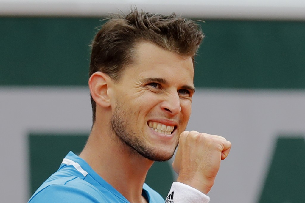 FILE - In this June 9, 2019, file photo, Austria's Dominic Thiem clenches his fist after scoring a point against Spain's Rafael Nadal during the men's...