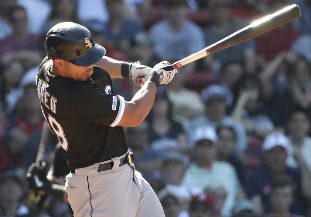 Chicago White Sox's Jose Abreu hits a two-run homer in the ninth inning of a baseball game against the Boston Red Sox at Fenway Park, Wednesday, June ...