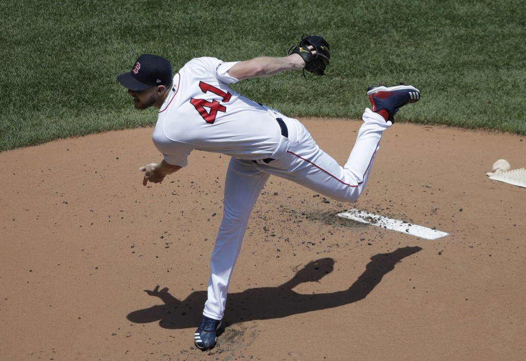 Boston Red Sox starting pitcher Chris Sale delivers to the Chicago White Sox in the first inning of a baseball game at Fenway Park, Wednesday, June 26...