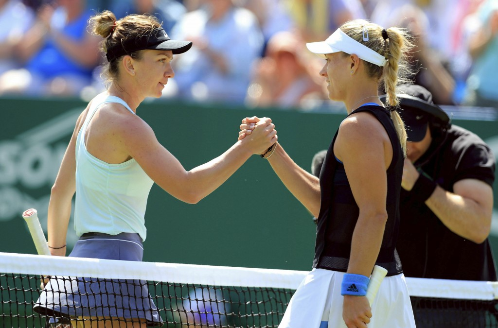 Angelique Kerber of Germany, right, shakes hands with Simona Halep of Romania, after defeating her at the quarter-finals of the Nature Valley Internat...