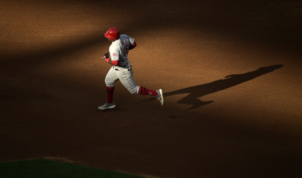 Cincinnati Reds' Yasiel Puig rounds second after hitting a solo home run during the fifth inning of a baseball game against the Los Angeles Angels Wed...