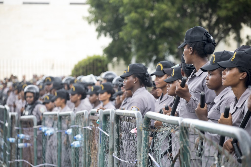 Police block access to the the National Congress during a protest against a Constitutional reform that would allow President Danilo Medina a third ter...