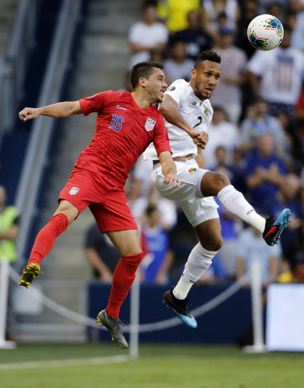 United States' Daniel Lovitz (16) and Panama' Francisco Palacios (2) go up for the ball during the first half of a CONCACAF Gold Cup soccer match in K...