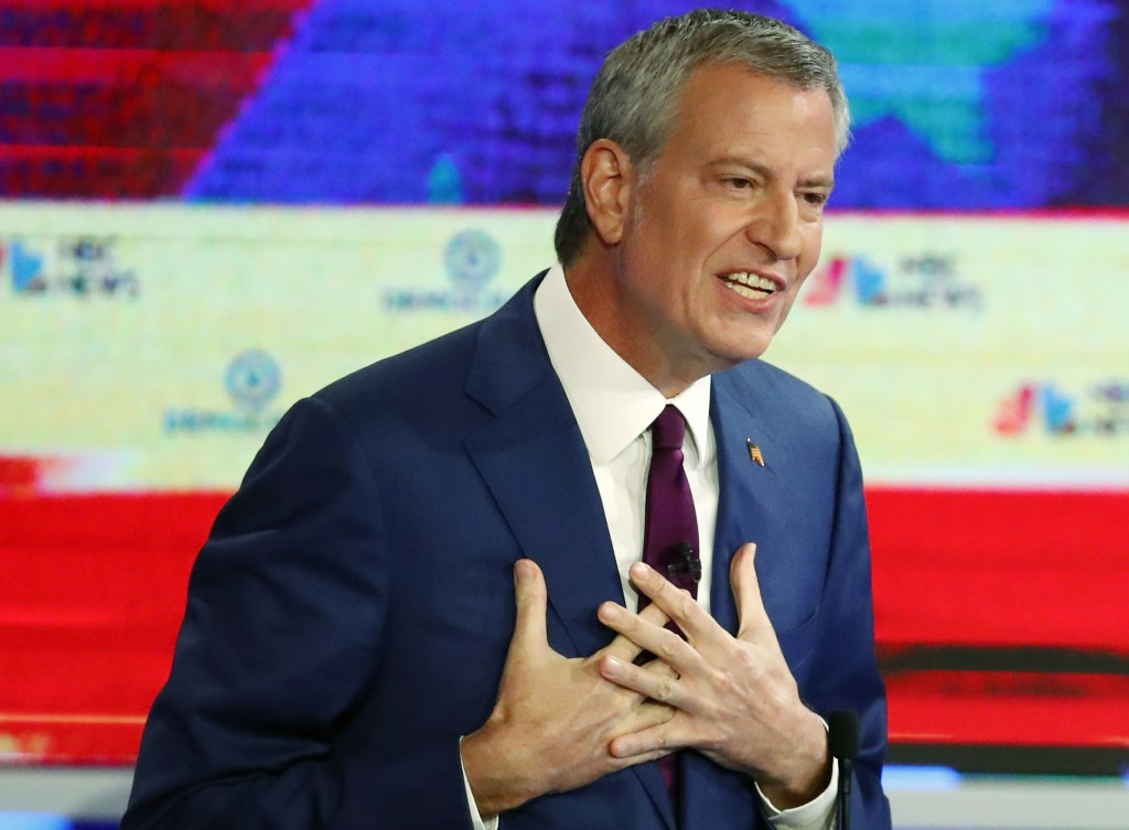 Democratic presidential candidate New York City Mayor Bill de Blasio gestures during a Democratic primary debate hosted by NBC News at the Adrienne Ar...