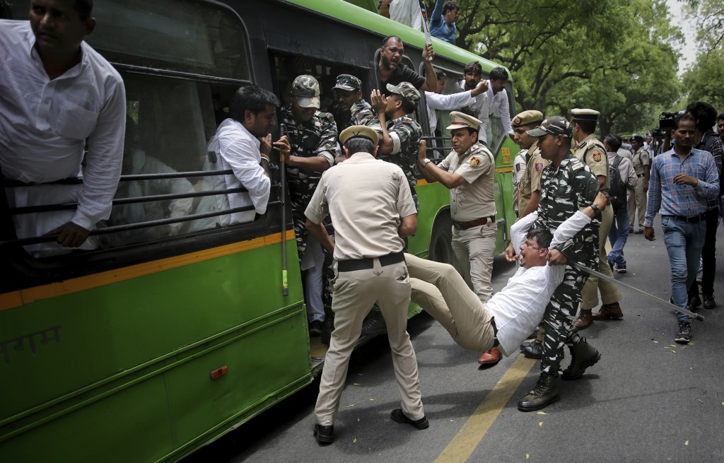 In this Thursday, June 27, 2019, file photo, Indian police detain activists of opposition Congress party's youth wing protesting against deaths of mor...