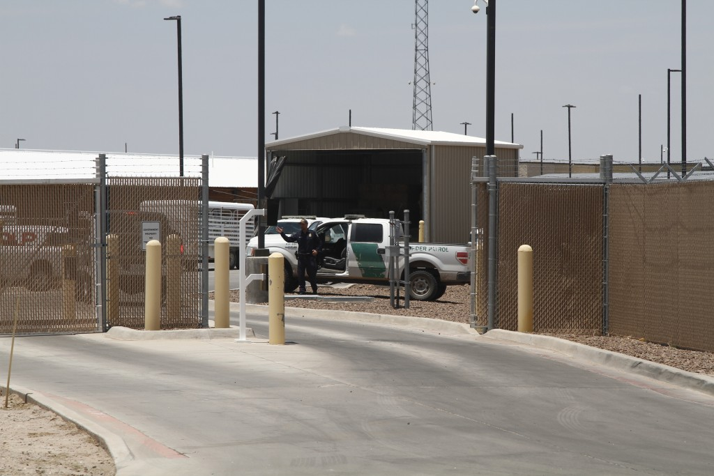 A Customs and Border Patrol officer guards the entrance to the Border Patrol station in Clint, Texas, Wednesday, June 26, 2019. The facility has been ...