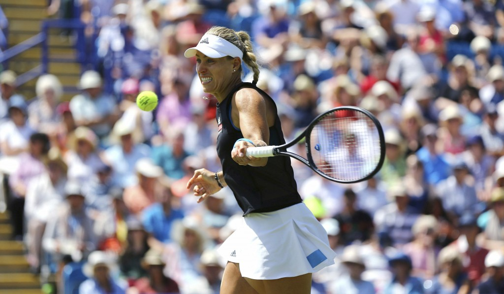 Angelique Kerber in action against Simona Halep during the singles match at the Eastbourne Open tennis tournament at Devonshire Park, Eastbourne, Engl...