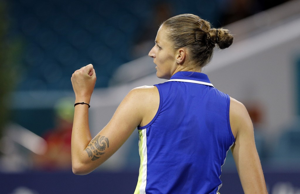 FILE - In this March 28, 2019, file photo, Karolina Pliskova, of the Czech Republic, clenches her fist after winning a set against Simona Halep, of Ro...