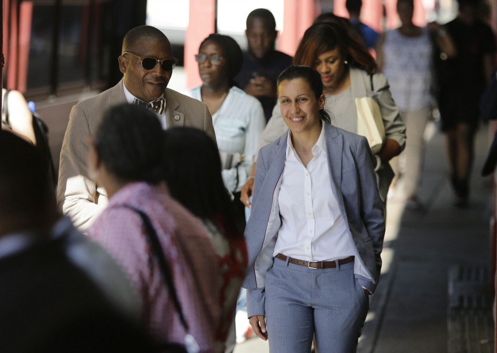 Queens district attorney candidate Tiffany Caban walks among commuters Wednesday, June 26, 2019, in the Queens borough of New York. With 99 percent of...