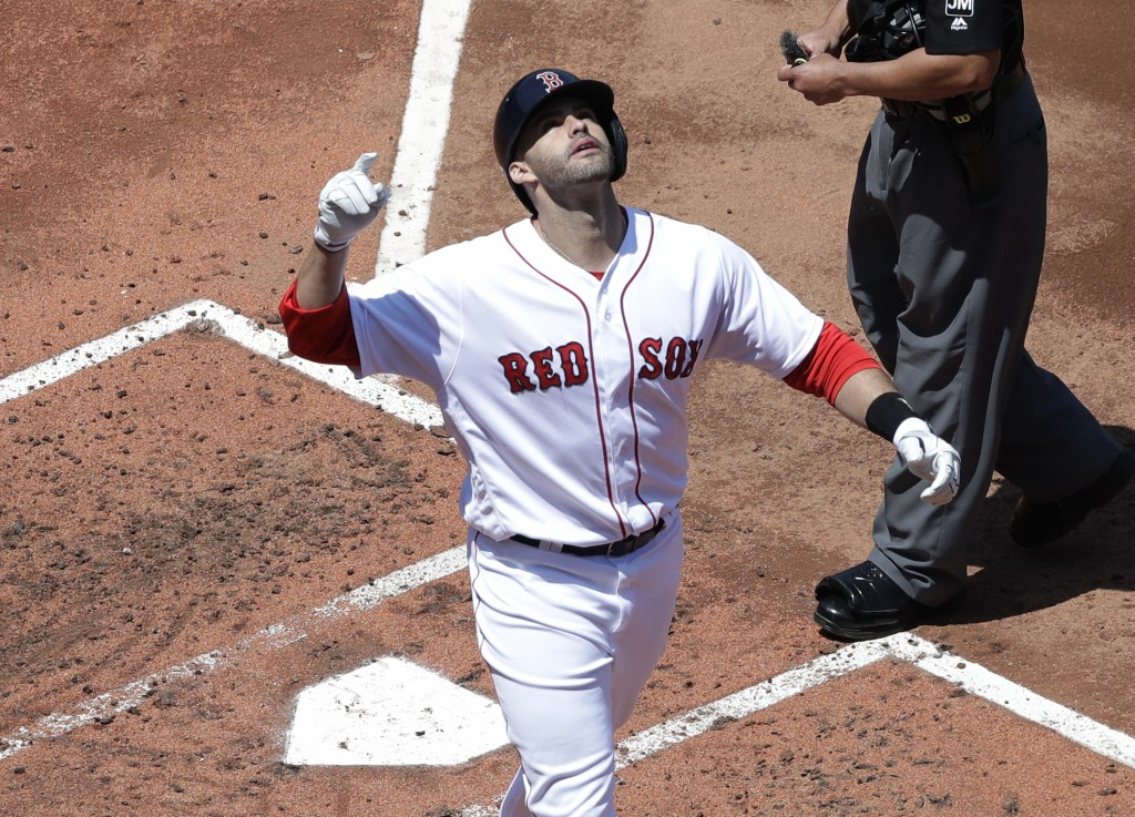 Boston Red Sox's J.D. Martinez celebrates his two-run homer in the first inning of a baseball game against the Chicago White Sox at Fenway Park, Wedne...
