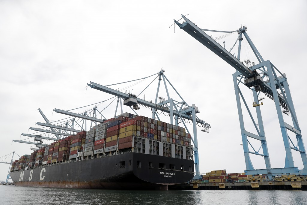 FILE - In this June 19, 2019, file photo a cargo ship is docked at the Port of Los Angeles in Los Angeles. On Thursday, June 27, the Commerce Departme...