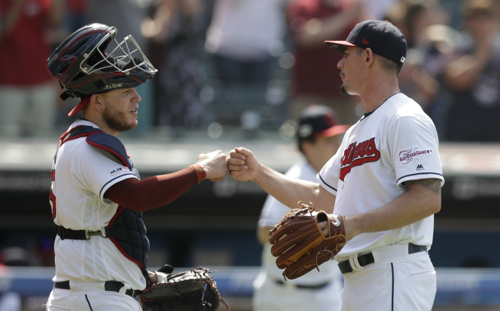 Cleveland Indians relief pitcher Nick Wittgren, right, is congratulated by catcher Roberto Perez after the Indians defeated the Kansas City Royals 5-3...