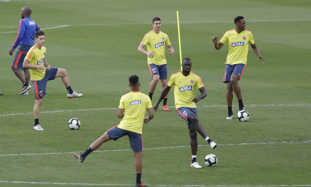 Colombia's James Rodriguez, left, and teammates attend a training session in Sao Paulo, Brazil, Wednesday, June 26, 2019. Colombia will face Chile on ...