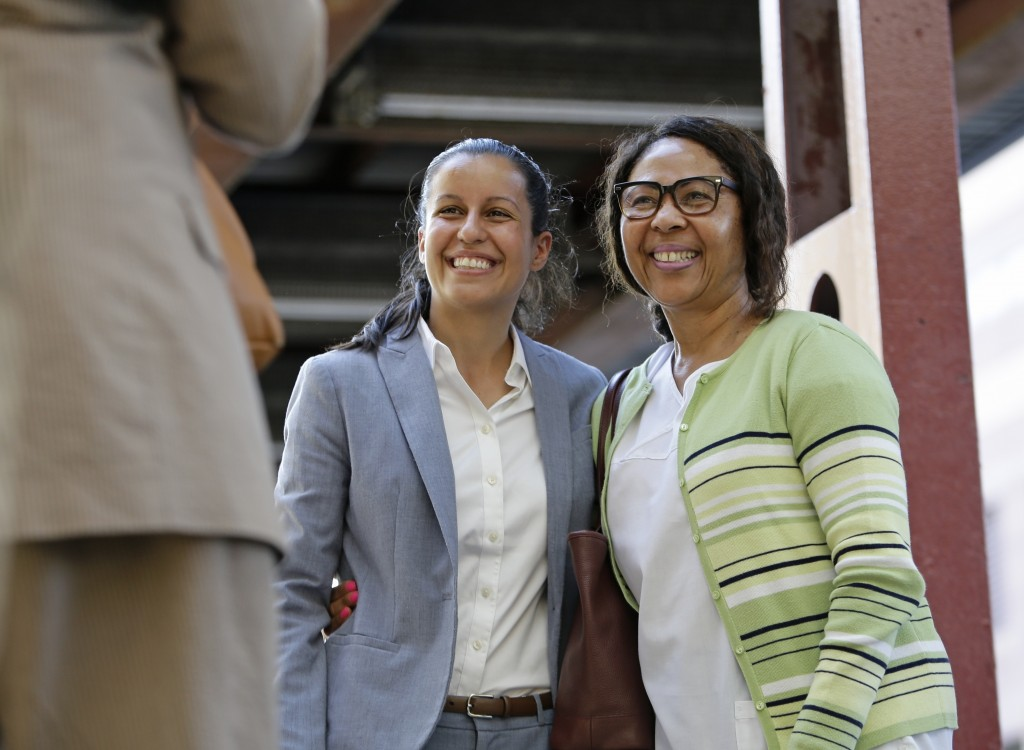 Queens district attorney candidate Tiffany Caban, center, poses for photographs with a commuter Wednesday, June 26, 2019, in the Queens borough of New...